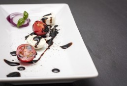 mozzarella and tomatoes dressed with balsamic vinegar from Modena I.G.P.